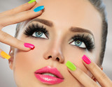 Fototapety Beauty girl face with colorful nail polish. Manicure and makeup