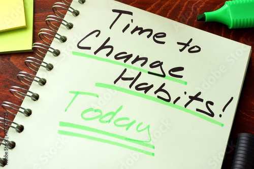 Time to change habits today written on a notepad. Motivation concept.