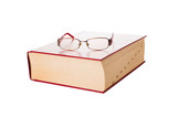Dictionary and eyeglasses on white background