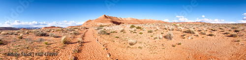 Desert landscape panorama with a path leading to hills.