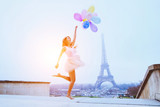 dream travel, girl with balloons jumping near Eiffel Tower in Paris - Fine Art prints