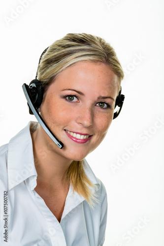 Leinwanddruck Bild Frau mit Headset im Kundenservice