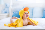 Fototapety Cute baby after bath in yellow duck towel