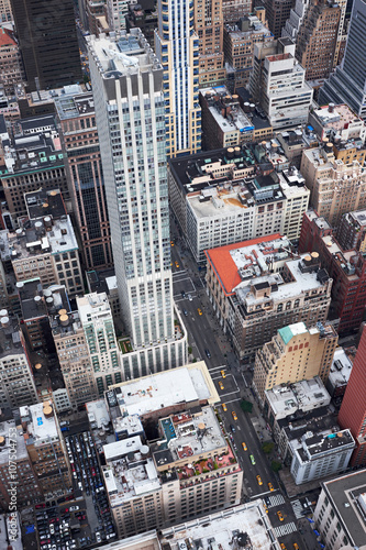 Aerial view of yellow cabs, and other traffics, on 5th Avenue NYC