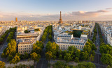 Paris from above showcasing rooftops, the Eiffel Tower, tree-lined avenues with haussmannian buildings lit by the setting sun. Avenue Kleber, Avenue d'Iena and Avenue Marceau, 16th arrondissement - 107526974