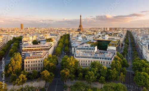 Paris from above showcasing rooftops, the Eiffel Tower, tree-lined avenues with haussmannian buildings lit by the setting sun. Avenue Kleber, Avenue d'Iena and Avenue Marceau, 16th arrondissement