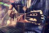 Young man playing guitar - 107577582