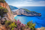 Fototapety Navagio beach with shipwreck and flowers against sunset on Zakynthos island in Greece