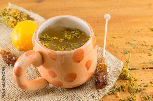 St Johns wort tea and surrounded by dried plants Photo by creativefamily