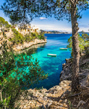 Mediterranean bay with rowboats at Cala Fornells Majorca Spain - 107608781