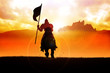 Silhouette of a medieval knight on horse carrying a flag