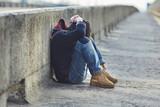 Fototapety young homeless boy sleeping on the bridge