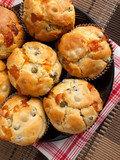 Savory muffins with ham, cheese dried tomatoes, shot from above