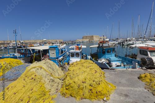 Aluminium Fishing nets and fishing boats near Venetian fortress in the por