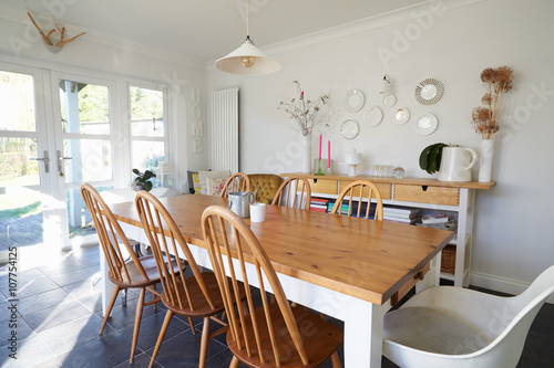 Dining Room In Contemporary Family Home Poster