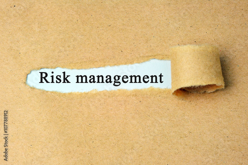 "Poster Torn paper with  ""risk management"" text."