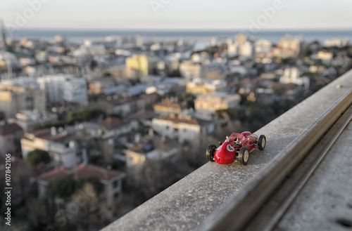 Fotobehang F1 Model of famous historical car from the window of a skyscraper
