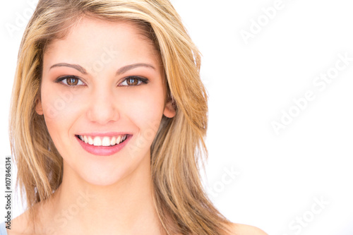 young blonde smiling woman portrait with perfect teeth isolated on white