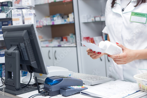 Close up Hand of Woman Pharmacist with Prescription and Medicine