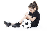 injury girl with soccer ball isolated on white