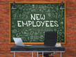 Green Chalkboard on the Red Brick Wall in the Interior of a Modern Office with Hand Drawn New Employees.  Business Concept with Doodle Style Elements. 3D.