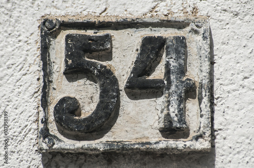 Poster Old retro weathered cast iron plate with number 54