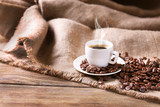 Fototapety Cup of coffee with sackcloth on table close-up