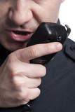 policeman talking on cb phone