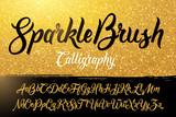 Calligraphic brushpen font with golden sparkles background - 108008381