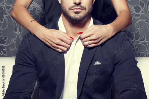 Woman hands undress sexy rich man