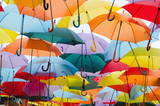 Fototapety colourful umbrellas hanging on the sky