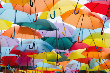 colourful umbrellas hanging on the sky © Alfonsodetomas