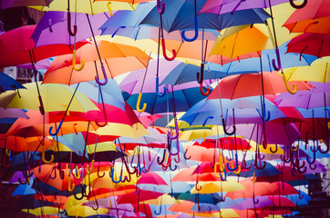 Colorful umbrellas hanging above the street © Alfonsodetomas