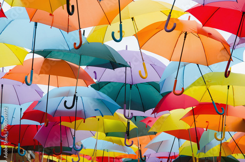 colourful umbrellas hanging on the sky