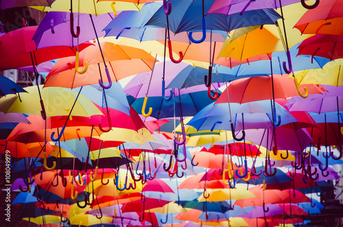 Colorful umbrellas hanging above the street
