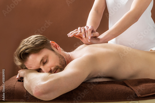 Young Man Receiving Back Massage At Spa Poster