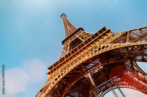 Eiffel Tower with lens flare and copy space. Poster