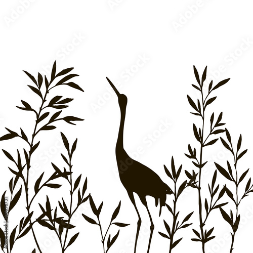 Naklejka heron in thicket of bamboo branches with leaves