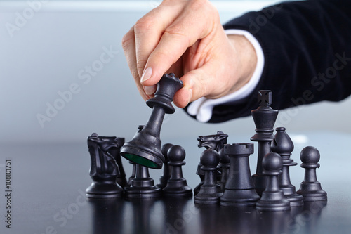 Poster businessman playing chess game