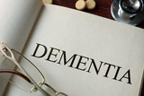 Book with diagnosis dementia and pills. Medical concept.