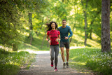 Young couple jogging at the woods.Green environment.  - 108123508
