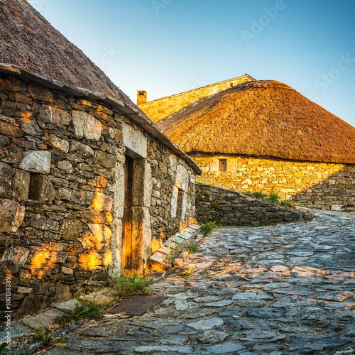 O Cebreiro, Spain. Historic stone huts at sunset