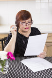 Successful mature woman with documents