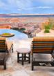 Infinity pool and lounge chairs with a view of endless desert
