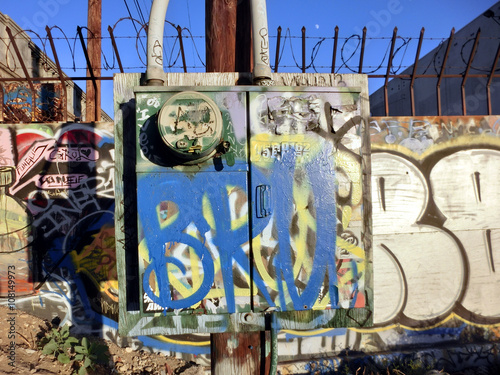 Urban ghetto electrical box with colorful painted graffiti - landscape color pho Poster