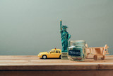 Travel to New York, USA concept with Statue of Liberty souvenir. Planning summer vacation, money budget trip concept.