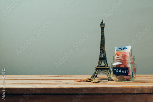 Foto op Plexiglas New York TAXI Travel to Paris, France concept with Eiffel Tower souvenir. Planning summer vacation, money budget trip concept.