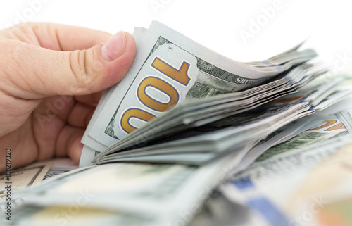 Poster Dollars in hand on a white background
