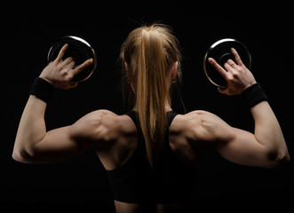 Young slim strong muscular woman posing in studio with dumbbell © Anton Gvozdikov