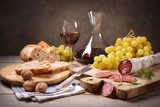Salami, grapes and red wine